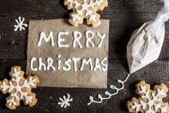 Christmas gingerbread, inscription and a bag of icing sugar on a Royalty Free Stock Images