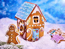 Christmas gingerbread man close up outside of cookie house. Royalty Free Stock Images