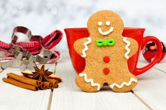 Christmas gingerbread man cookie with hot chocolate and twinkling background Stock Photo