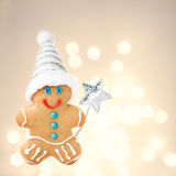 Christmas Gingerbread Man Cookie with Santa hat  on sparkling fe Stock Image