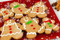 Christmas gingerbread man cookies on festive red plate Royalty Free Stock Image