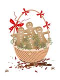 Christmas Gingerbread Man Cookies in Gift Basket. Llustration of Christmas Gingerbread Man Cookies Decorated with White Icing on A Beautiful Wicker Basket for Royalty Free Stock Photography
