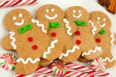 Christmas gingerbread man cookies on plate with candy Royalty Free Stock Photos