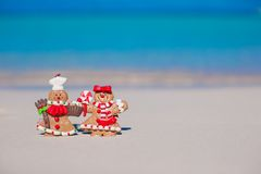 Christmas gingerbread man cookies on a white sandy Stock Photo