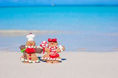 Christmas gingerbread man cookies on a white sandy Stock Image