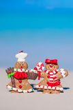 Christmas gingerbread man cookies on a white sandy Royalty Free Stock Photo