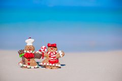 Christmas gingerbread man cookies on a white sandy Royalty Free Stock Photography