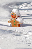 Christmas gingerbread man covered in snow Stock Image
