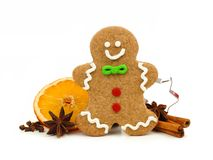 Christmas gingerbread man with holiday spices over white Royalty Free Stock Photo