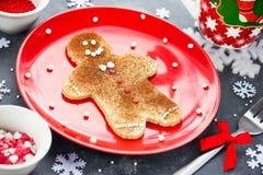 Christmas gingerbread man pancake with cinnamon sugar. Christmas Royalty Free Stock Image