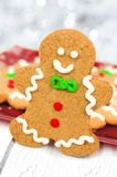 Christmas gingerbread man with plate of cookies in background Royalty Free Stock Image