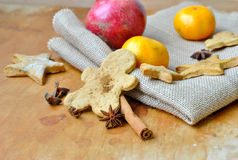 Christmas gingerbread man and a star anise and tangerines Stock Photo