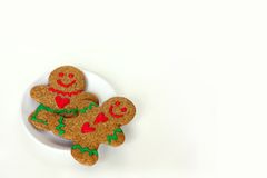 Christmas Gingerbread Man and Woman on Plate Isolated Stock Photography