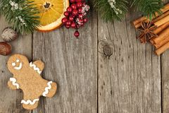 Christmas gingerbread man on wooden background with tree branch border Royalty Free Stock Photo