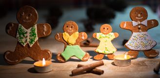Christmas gingerbread men candles Stock Images
