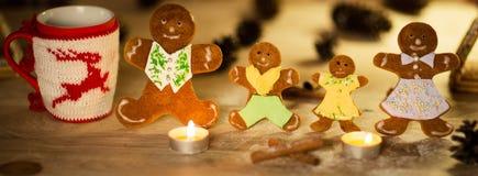 Christmas gingerbread men candles with cinnamon stars Pine twig Christmas ball Stock Image