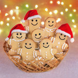 Christmas gingerbread men cookies in Santa hats against lights b. Many positive Christmas gingerbread men cookies in Santa Claus hats at straw bowl against Stock Photo