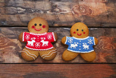 Free Christmas Gingerbread Men On Wooden Background. Royalty Free Stock Photo - 81375605