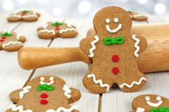 Christmas gingerbread men with rolling pin Royalty Free Stock Images