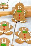 Christmas gingerbread men with rolling pin Stock Photo