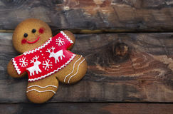 Christmas gingerbread men on wooden background. Smiling christmas gingerbread men on wooden background Stock Images