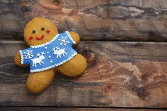 Christmas gingerbread men on wooden background. Smiling christmas gingerbread men on wooden background Stock Image