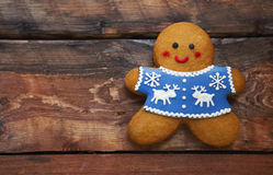 Christmas gingerbread men on wooden background. Smiling christmas gingerbread men on the table Royalty Free Stock Photos