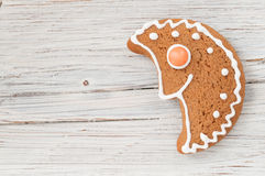 Christmas gingerbread moon on wooden background Stock Image