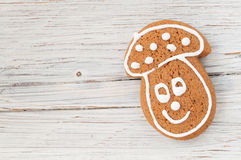 Christmas gingerbread mushroom on wooden background Royalty Free Stock Images