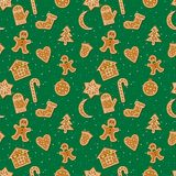 Christmas gingerbread pattern. Vector seamles pattern with Christmas ginger bread cookies. Gingerbread men and Christmas tree, star, bell, house, cane, moon and Royalty Free Stock Photo