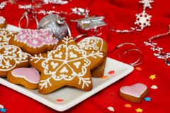 Christmas gingerbread on red background. New Year`s composition. Gingerbread and Christmas decorations. Red background Royalty Free Stock Photo