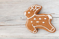 Christmas gingerbread reindeer on wooden background Royalty Free Stock Photography