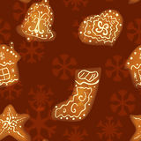 Christmas gingerbread seamless pattern. Surrounded by falling snowflakes Stock Photos