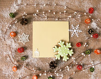 Christmas gingerbread snowflake. Top view with greeting card, copy space Royalty Free Stock Images