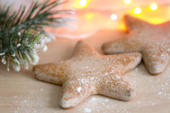Christmas gingerbread star on board with fir Stock Images