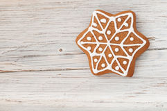 Christmas gingerbread star on wooden background Stock Image