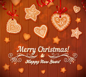 Christmas gingerbread stars and hearts greeting Royalty Free Stock Images
