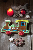 Christmas gingerbread train with candle cinnamon stars pine twig christmas bulb on wooden floor Royalty Free Stock Image