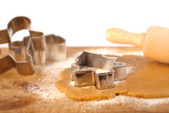 Christmas gingerbread tree cookie cutter on dough Stock Photography