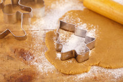 Christmas gingerbread tree cookie cutter on dough Stock Images