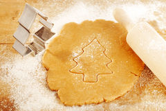 Christmas gingerbread tree cookies with cutter Stock Photo