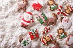 Christmas gingerbread on white flour background. Horizontal top Stock Photo