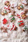 Christmas gingerbread on white flour background. vertical top vi Royalty Free Stock Photos