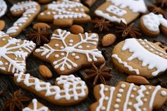 Homemade christmas gingerbread on a wooden background with star anise and almond. Christmas gingerbread on a wooden background with star anise and almond Stock Images