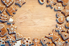 Christmas gingerbread on wooden table. Christmas frame background Royalty Free Stock Image
