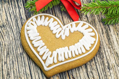 Christmas gingerbread on a wooden table with fir branches Royalty Free Stock Photo