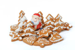 Christmas gingerbreads and ceramic santa on white background Stock Photo