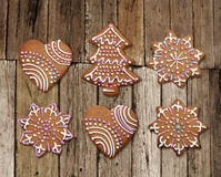 Christmas gingerbreads on old rough wood plank Stock Images