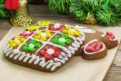 Christmas gingerbreads on paper Royalty Free Stock Image