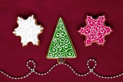 Christmas gingerbreads on red background royalty free stock photography